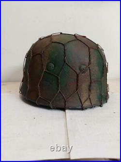 World War II German M38 Fallschirmjager Chickenwire Camo Painted Aged Helmet